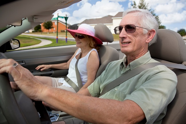 elderly couple driving in car