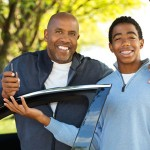 Parent handing car keys to his teen driver