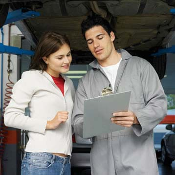 Woman talking with a mechanic