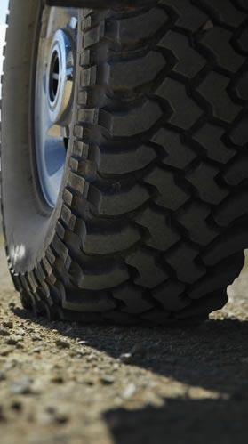Car tire on gravel