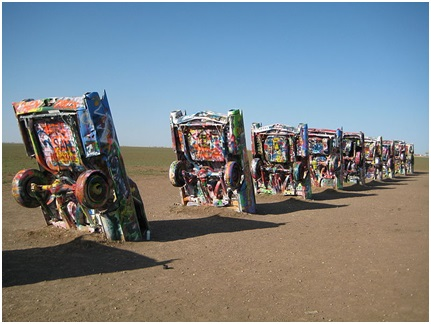 Row of Cadillacs buried in the ground