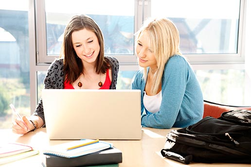 Two girls take an online driver license prep course
